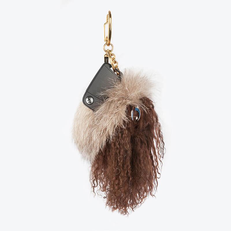 Portachiavi pelliccia volpe pon-pon charms borsa pelle marrone | Nicola Pelliccerie